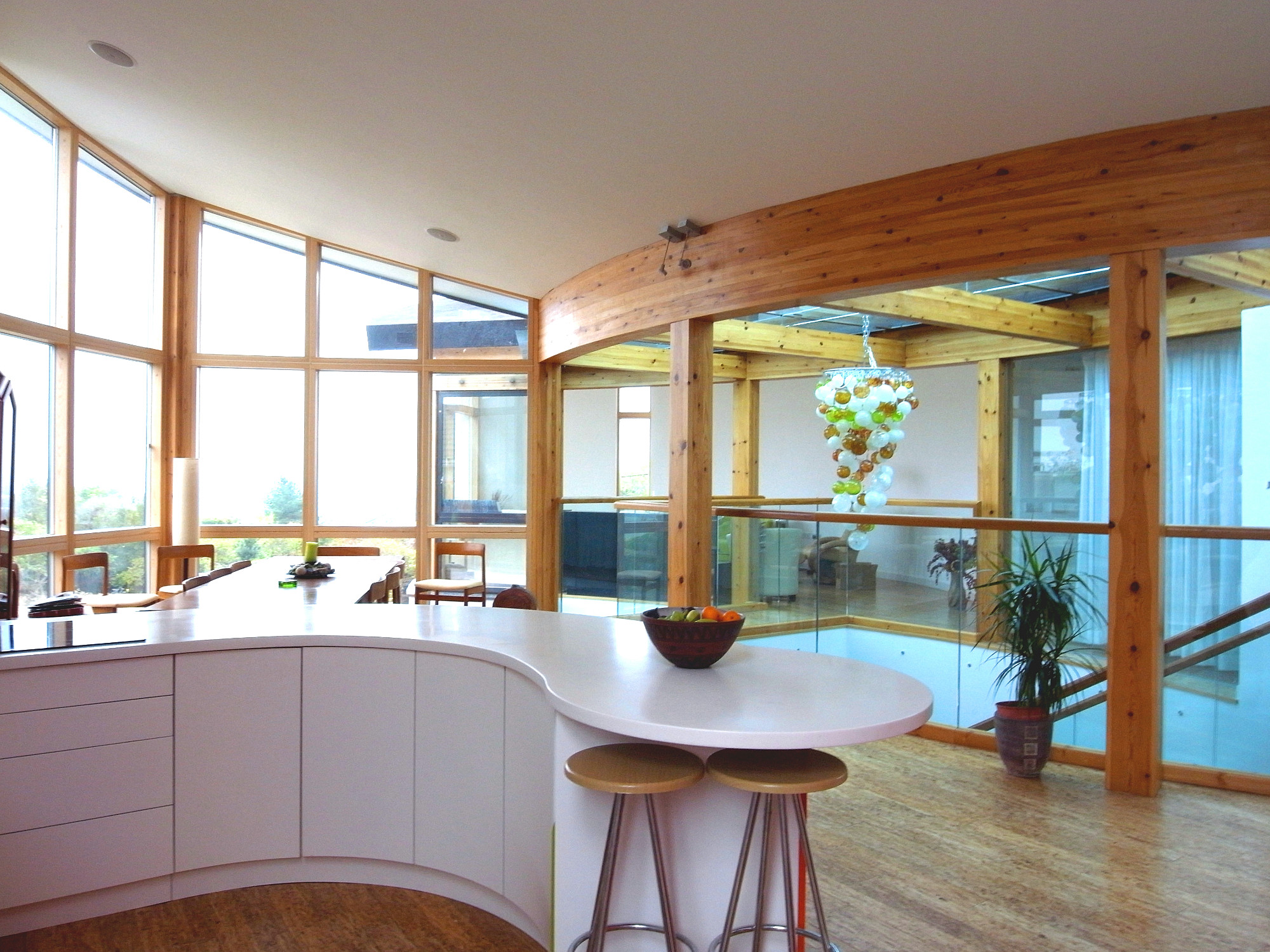 Curved kitchen overlooking the open space