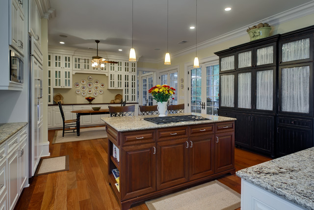 Eat-in kitchen - traditional eat-in kitchen idea in Charleston with glass-front cabinets and white cabinets