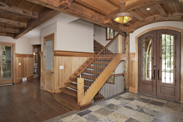 Custom cabinetry featured in a custom post and beam house on Lake Lanier. eclectic-kitchen