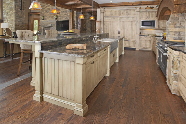 Custom cabinetry featured in a custom post and beam house for Post and beam kitchen ideas