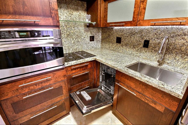 custom cabinetry granite and stainless steel appliances in only 50 sq ft tropical kitchen