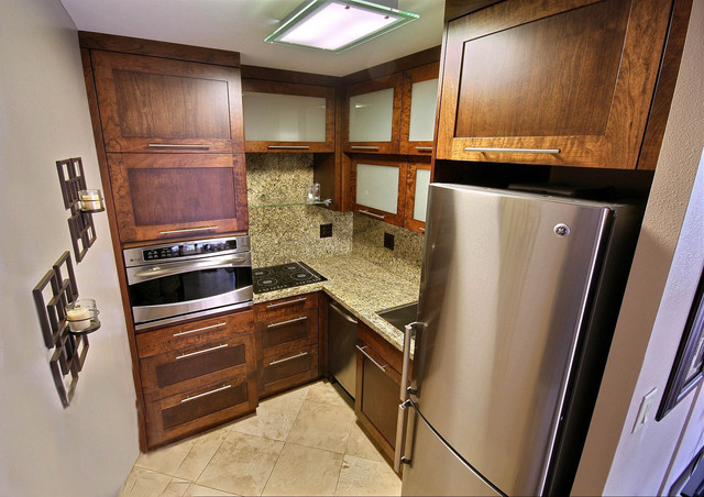 Custom cabinetry, granite and stainless steel appliances in only 50 sq ft tropical kitchen