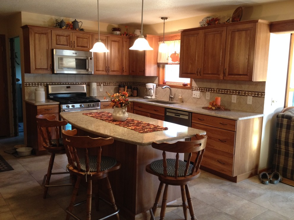 Custom Calico Hickory kitchen stained in Medium Brown ...