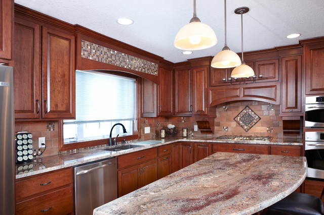Custom cherry cabinets / Juparana Bordeaux granite traditional-kitchen