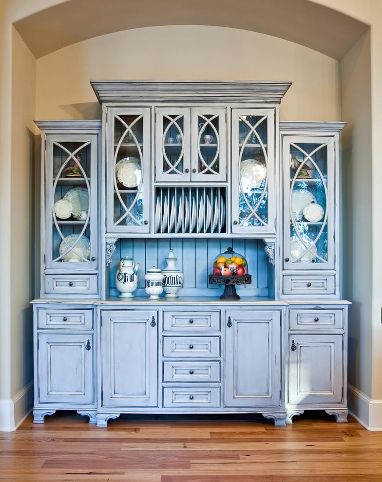 Elegant kitchen photo in Charleston with blue cabinets