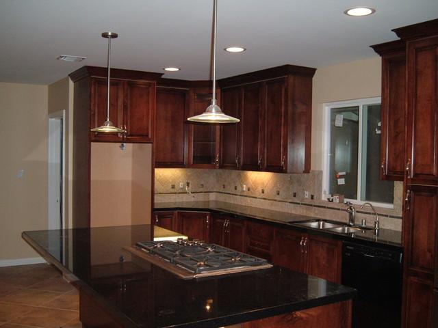 Custom dark mahogany stained maple kitchen for Royal mahogany kitchen designs