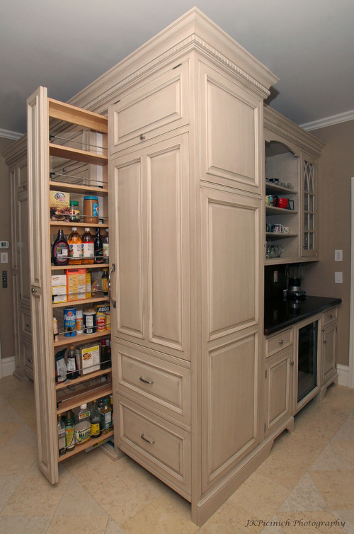 Pantry pull out vs door with attached storage for Pull out drawers for kitchen cabinets