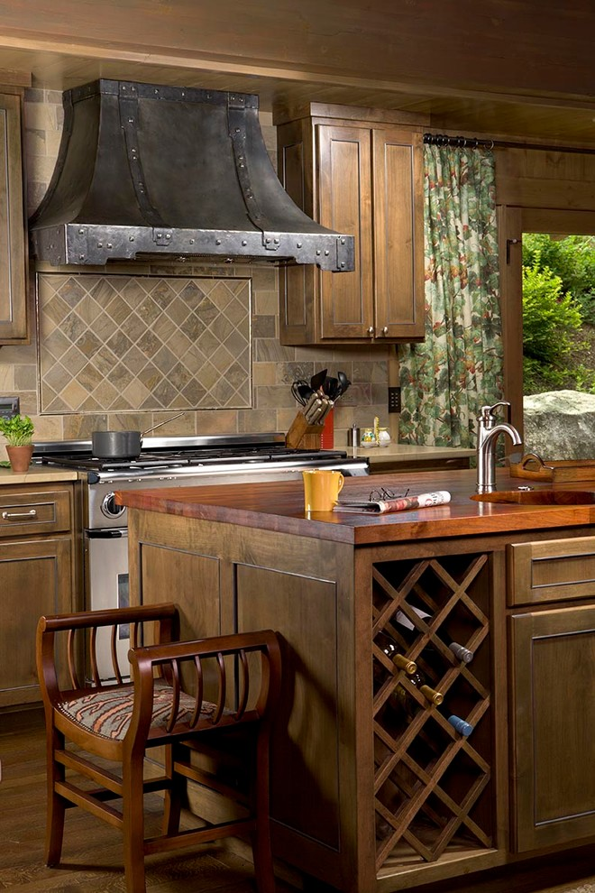 Kitchen - rustic kitchen idea in Other with recessed-panel cabinets, medium tone wood cabinets, wood countertops, multicolored backsplash, stainless steel appliances and slate backsplash