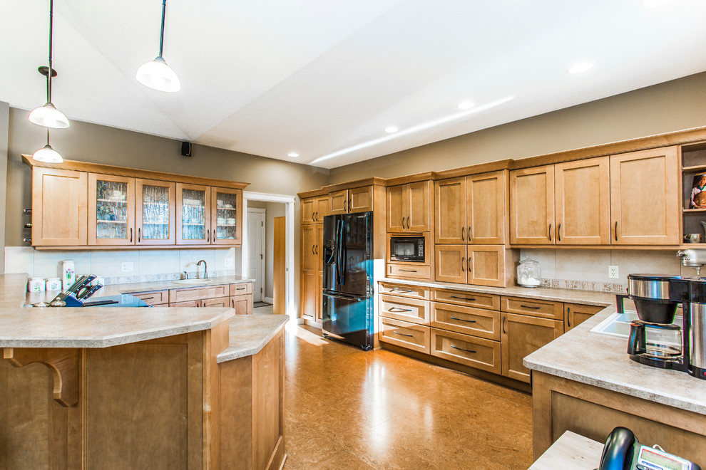 Custom designed kitchen with maple cabinets