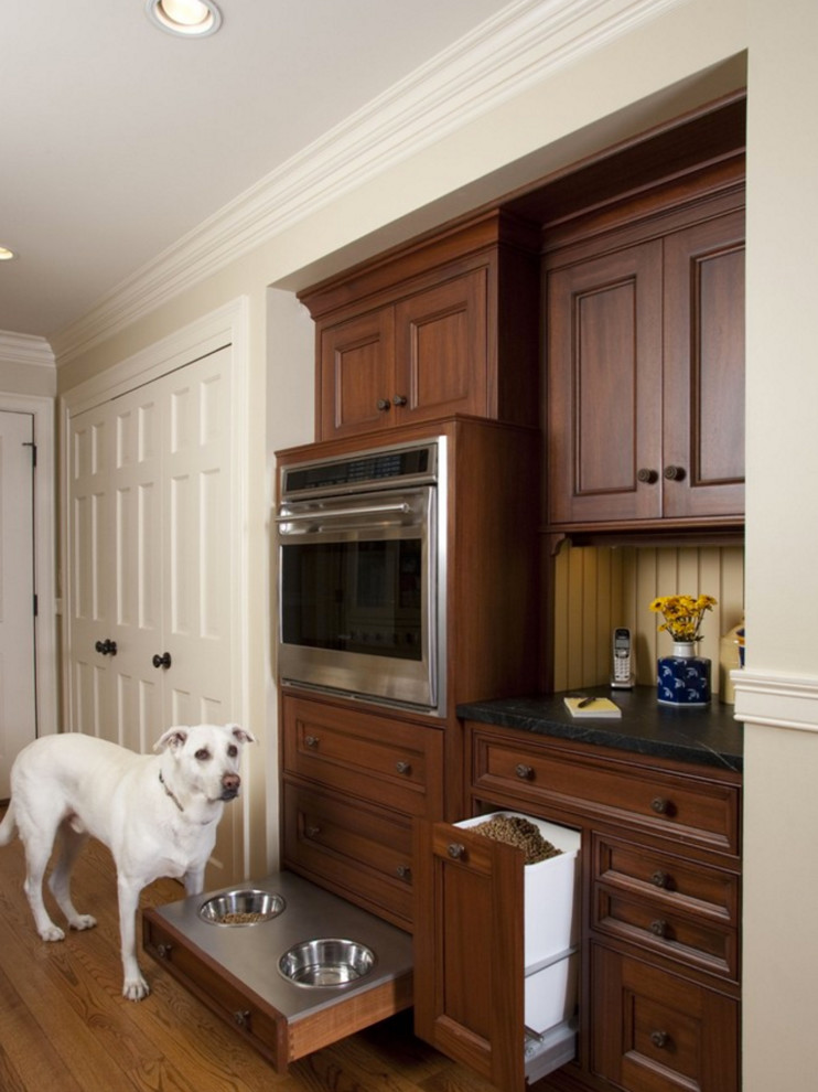 Kitchen - traditional medium tone wood floor kitchen idea in Other with soapstone countertops, yellow backsplash and stainless steel appliances