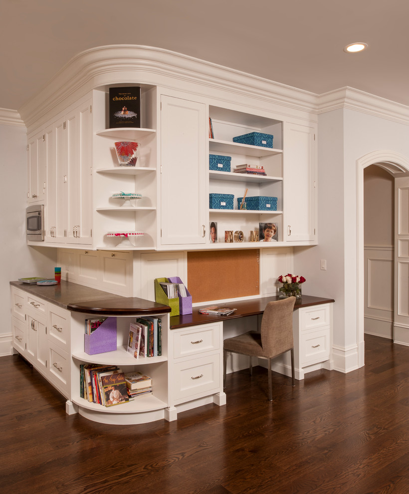 Inspiration for a timeless kitchen remodel in Raleigh with shaker cabinets, beige cabinets and wood countertops