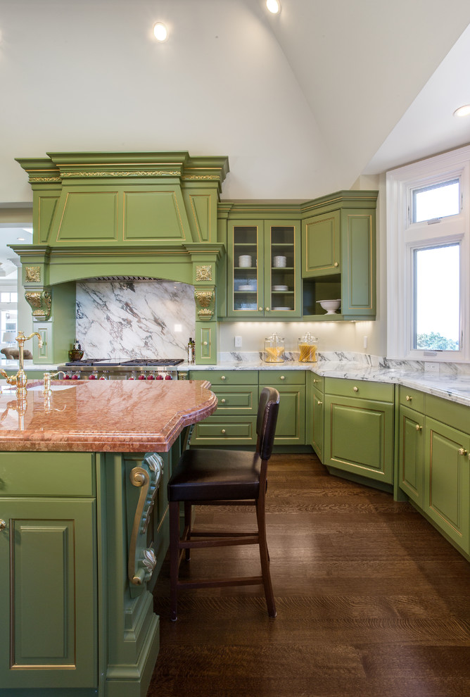 Inspiration for a timeless u-shaped dark wood floor kitchen remodel in San Francisco with raised-panel cabinets, green cabinets, white backsplash, stainless steel appliances and an island