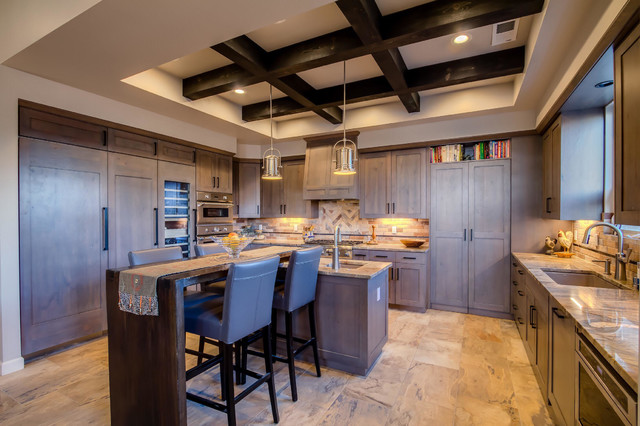 Inspiration for a transitional beige floor eat-in kitchen remodel in Albuquerque with an integrated sink, gray cabinets, granite countertops, beige backsplash, stainless steel appliances and two islands