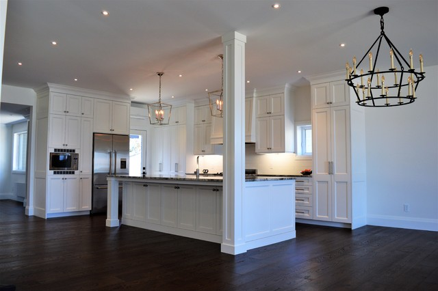 Inspiration for a huge timeless l-shaped dark wood floor and brown floor eat-in kitchen remodel in Toronto with an undermount sink, shaker cabinets, white cabinets, granite countertops, white backsplash, ceramic backsplash, stainless steel appliances, an island and multicolored countertops
