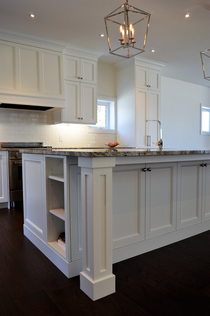 Huge elegant l-shaped dark wood floor and brown floor eat-in kitchen photo in Toronto with an undermount sink, shaker cabinets, white cabinets, granite countertops, white backsplash, ceramic backsplash, stainless steel appliances, an island and multicolored countertops
