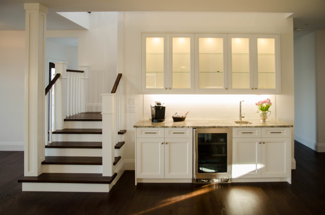Huge transitional u-shaped eat-in kitchen photo in Toronto with a double-bowl sink, shaker cabinets, white cabinets, granite countertops, white backsplash, subway tile backsplash, stainless steel appliances, an island and multicolored countertops