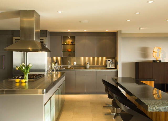 Example of a large trendy u-shaped ceramic floor and beige floor open concept kitchen design in Hawaii with an integrated sink, flat-panel cabinets, gray cabinets, stainless steel countertops, metallic backsplash, metal backsplash, stainless steel appliances, an island and multicolored countertops