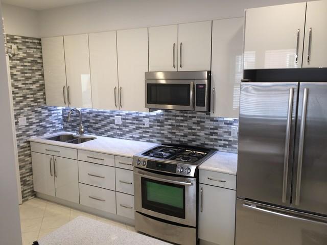 Custom Kitchen In White Acrylic