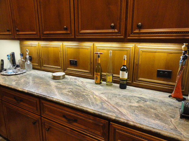 CUSTOM ONYX, SOAPSTONE, AND LIMESTONE eclectic-kitchen