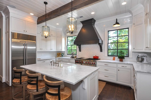 Inspiration for a timeless u-shaped dark wood floor kitchen remodel in Atlanta with an undermount sink, beaded inset cabinets, white cabinets, white backsplash, stainless steel appliances and an island