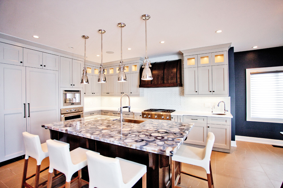 Inspiration for a transitional l-shaped kitchen remodel in Toronto with recessed-panel cabinets, gray cabinets, white backsplash and paneled appliances