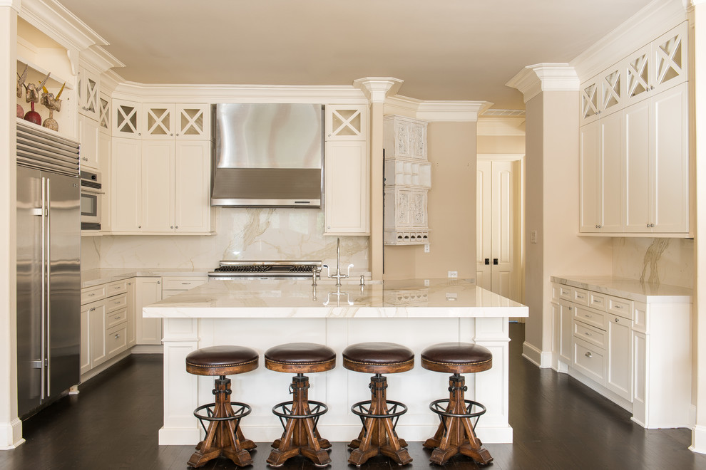 Large transitional u-shaped dark wood floor and brown floor eat-in kitchen photo in Houston with shaker cabinets, white cabinets, white backsplash, stainless steel appliances, an island, a farmhouse sink, granite countertops and stone slab backsplash