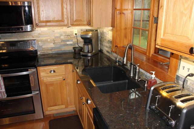 Cygnus coffee brown granite rustic kitchen kansas for Midwest kitchen and bath