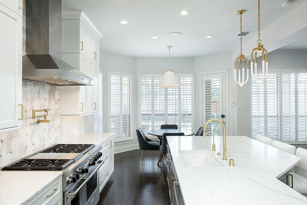 Inspiration for a huge transitional galley dark wood floor and brown floor open concept kitchen remodel in Dallas with an undermount sink, shaker cabinets, white cabinets, quartz countertops, white backsplash, marble backsplash, stainless steel appliances and an island