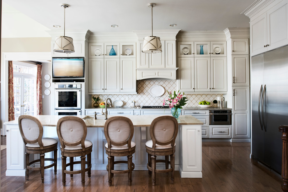 Elegant l-shaped dark wood floor kitchen photo in Atlanta with an undermount sink, raised-panel cabinets, white cabinets, white backsplash, stainless steel appliances and an island