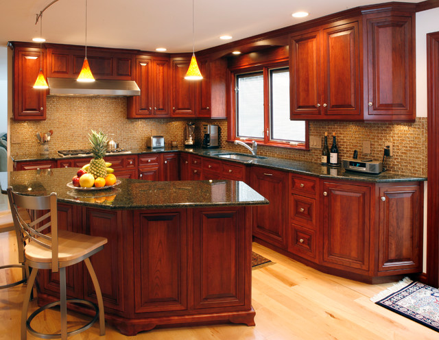 Cherry Wood Floors With Brown Walls In Kitchens