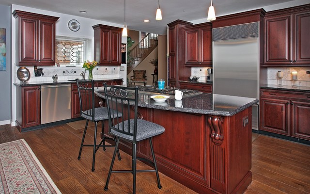Dark cherry with gray accents traditional kitchen for Grey kitchen cabinets with red walls