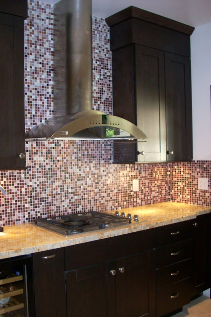 Dark oak cabinets with glass tile backsplash contemporary kitchen
