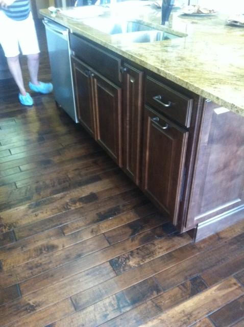 Dark trim and decor help contemporary-kitchen