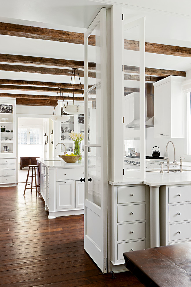 Example of a mountain style kitchen design in Other with white cabinets, white backsplash and beaded inset cabinets