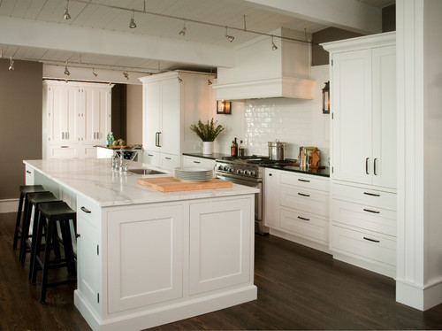 A white kitchen design with White inset cabinets from Dura Supreme in a nautical interior design.