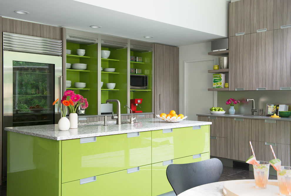 Inspiration for a contemporary l-shaped eat-in kitchen remodel in New York with flat-panel cabinets, gray cabinets, metallic backsplash, stainless steel appliances and an island