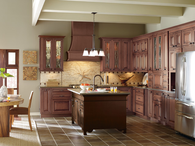 Medium wood kitchen cabinets with contrasting dark wood for Traditional dark kitchen cabinets