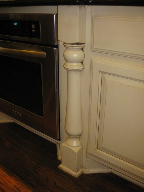 decorative post next to oven by Burrows Cabinets ...
