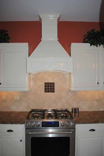 White Kitchen Hood decorative range hood, soft white cabinets, travertine backsplash