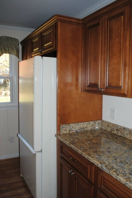 Deep Cabinet Above The Refrigerator And A Wood Panel On