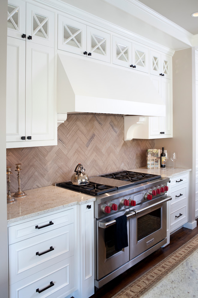 Inspiration for a timeless l-shaped eat-in kitchen remodel in DC Metro with a farmhouse sink, raised-panel cabinets, white cabinets, granite countertops, gray backsplash, stainless steel appliances and limestone backsplash