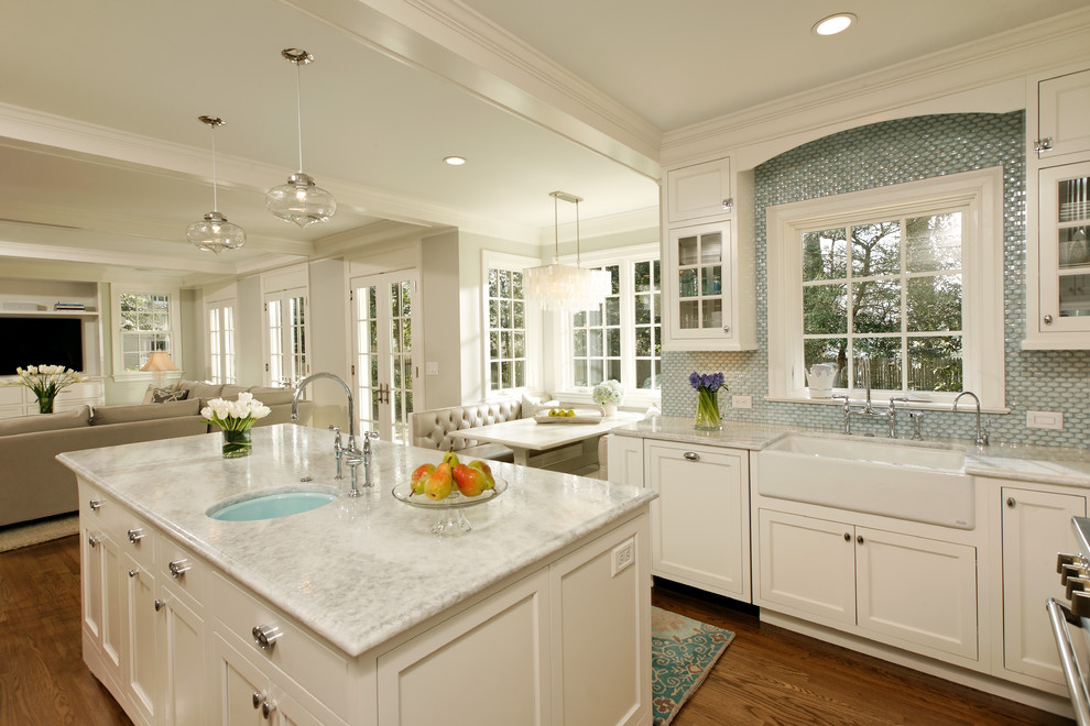 Example of a classic open concept kitchen design in DC Metro with a farmhouse sink, blue backsplash, white cabinets, quartzite countertops and recessed-panel cabinets