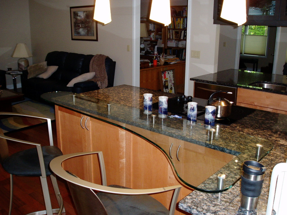 Inspiration for a timeless l-shaped eat-in kitchen remodel in Other with an undermount sink, raised-panel cabinets, light wood cabinets and glass countertops