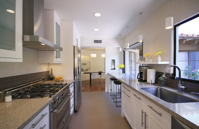 Example of a trendy galley enclosed kitchen design in Phoenix with  stainless steel appliances, a