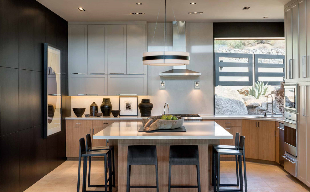 Kitchen - contemporary beige floor kitchen idea in Phoenix with an undermount sink, flat-panel cabinets, light wood cabinets, gray backsplash, stainless steel appliances, an island and gray countertops