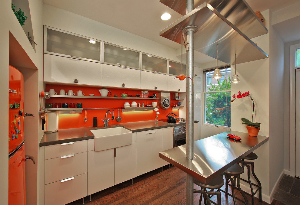 Kitchen - industrial kitchen idea in DC Metro with a farmhouse sink, concrete countertops and colored appliances