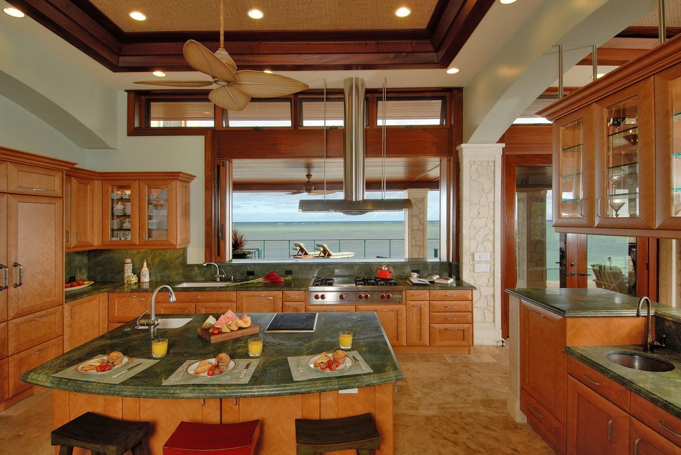 Beach style eat-in kitchen photo in Hawaii with glass-front cabinets, medium tone wood cabinets, green backsplash, stone slab backsplash, granite countertops, a single-bowl sink, paneled appliances and green countertops