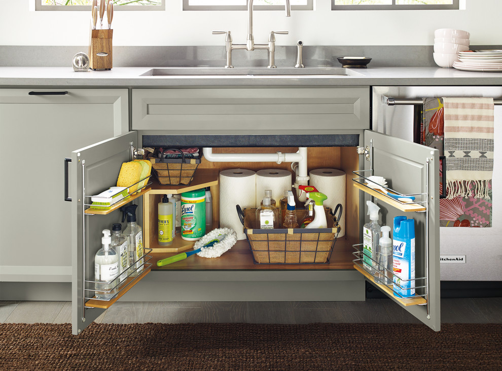Inspiration for a transitional kitchen remodel with an integrated sink and an island