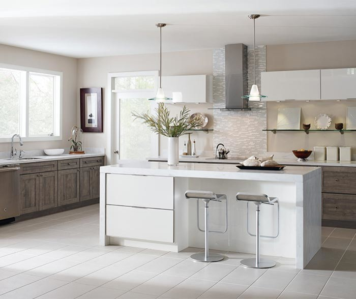 Inspiration for a transitional kitchen pantry remodel with an integrated sink, shaker cabinets, white cabinets, stainless steel appliances, an island and white countertops