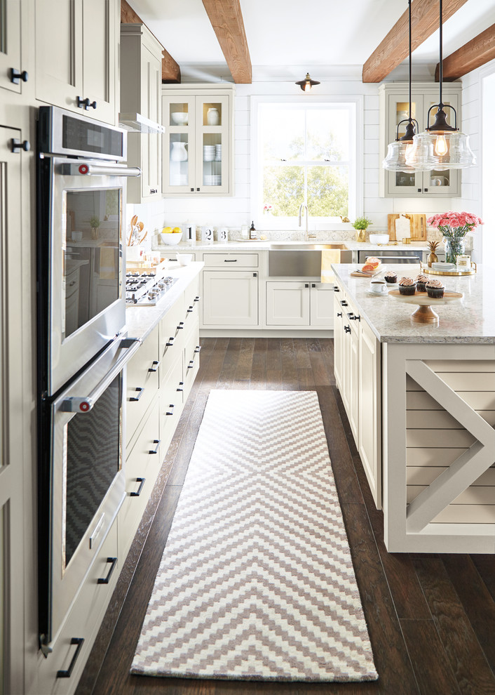 Cottage dark wood floor and brown floor eat-in kitchen photo in Other with stainless steel appliances and an island